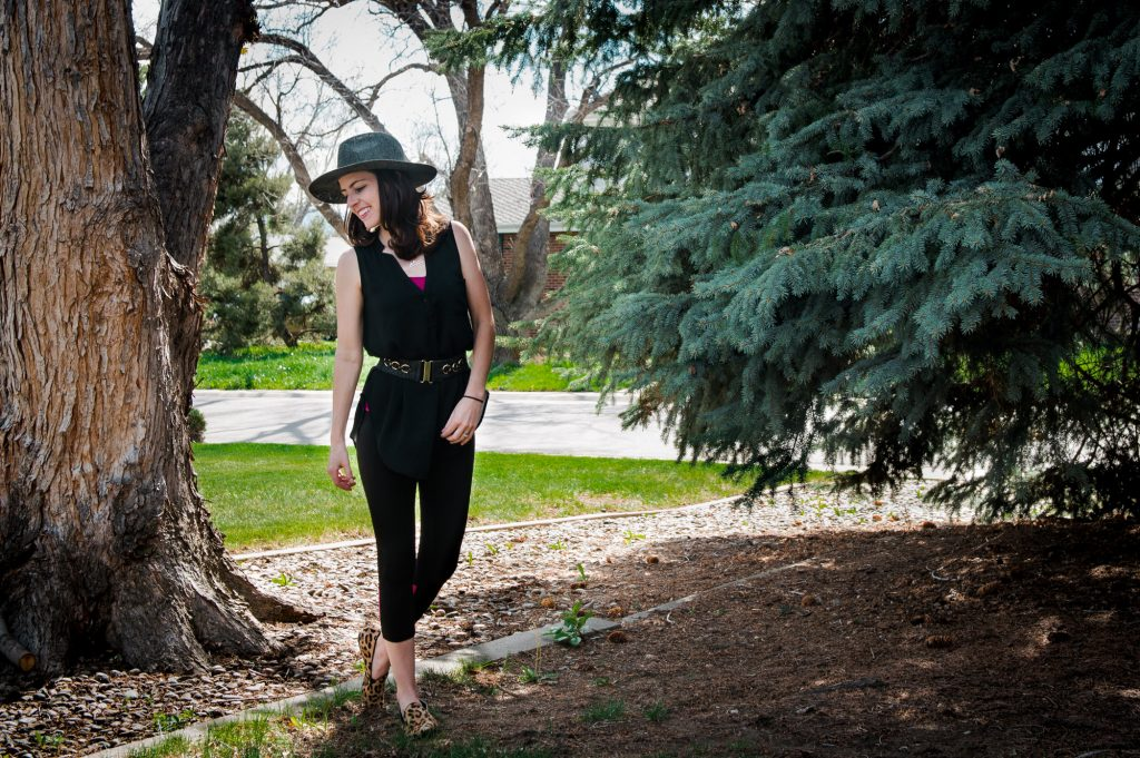 Loungewear in your backyard. Tank with belt and yoga pants topped with hat and animal print shoes