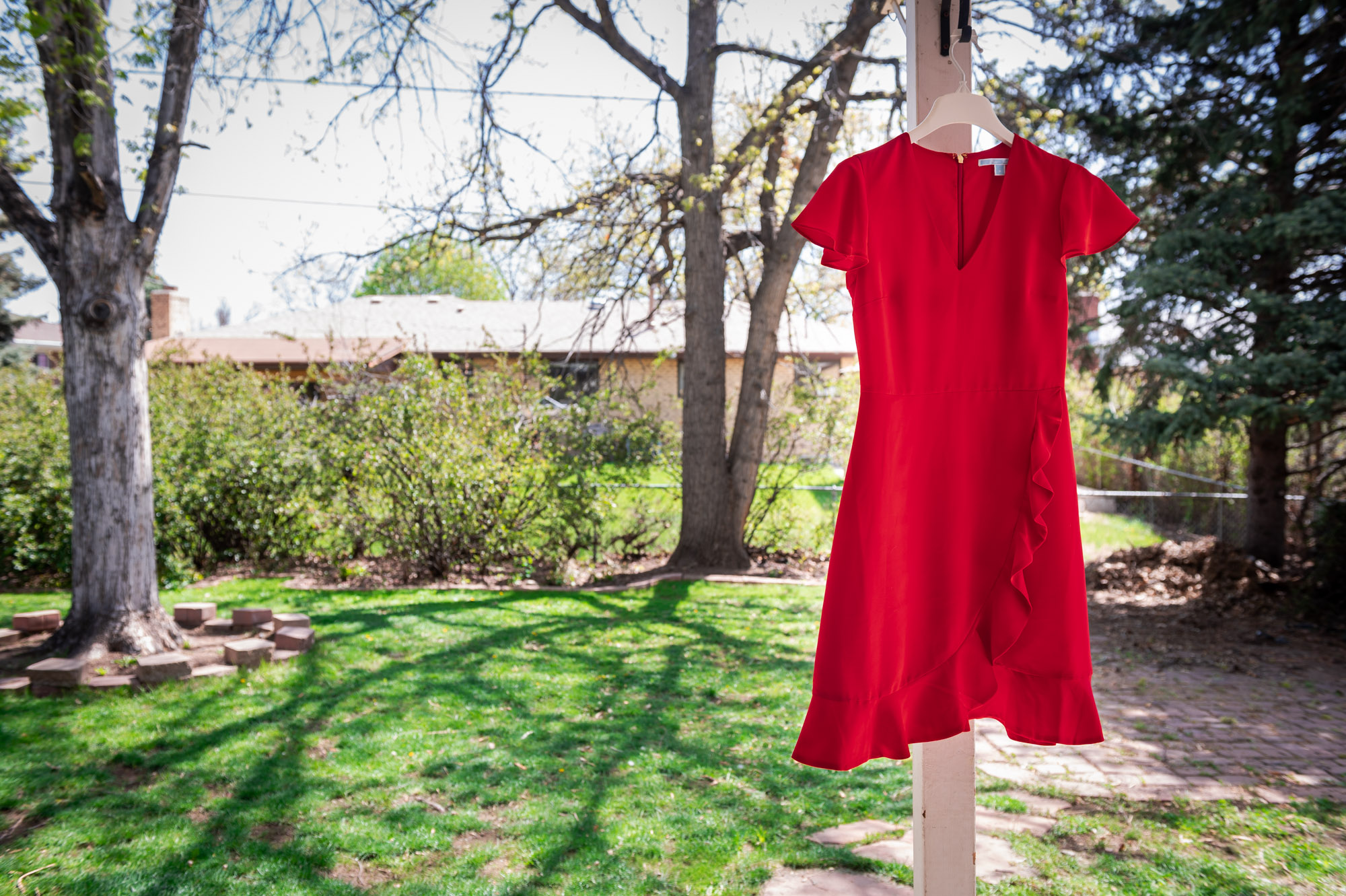 Red Summer dress blowing in the wind while hung up