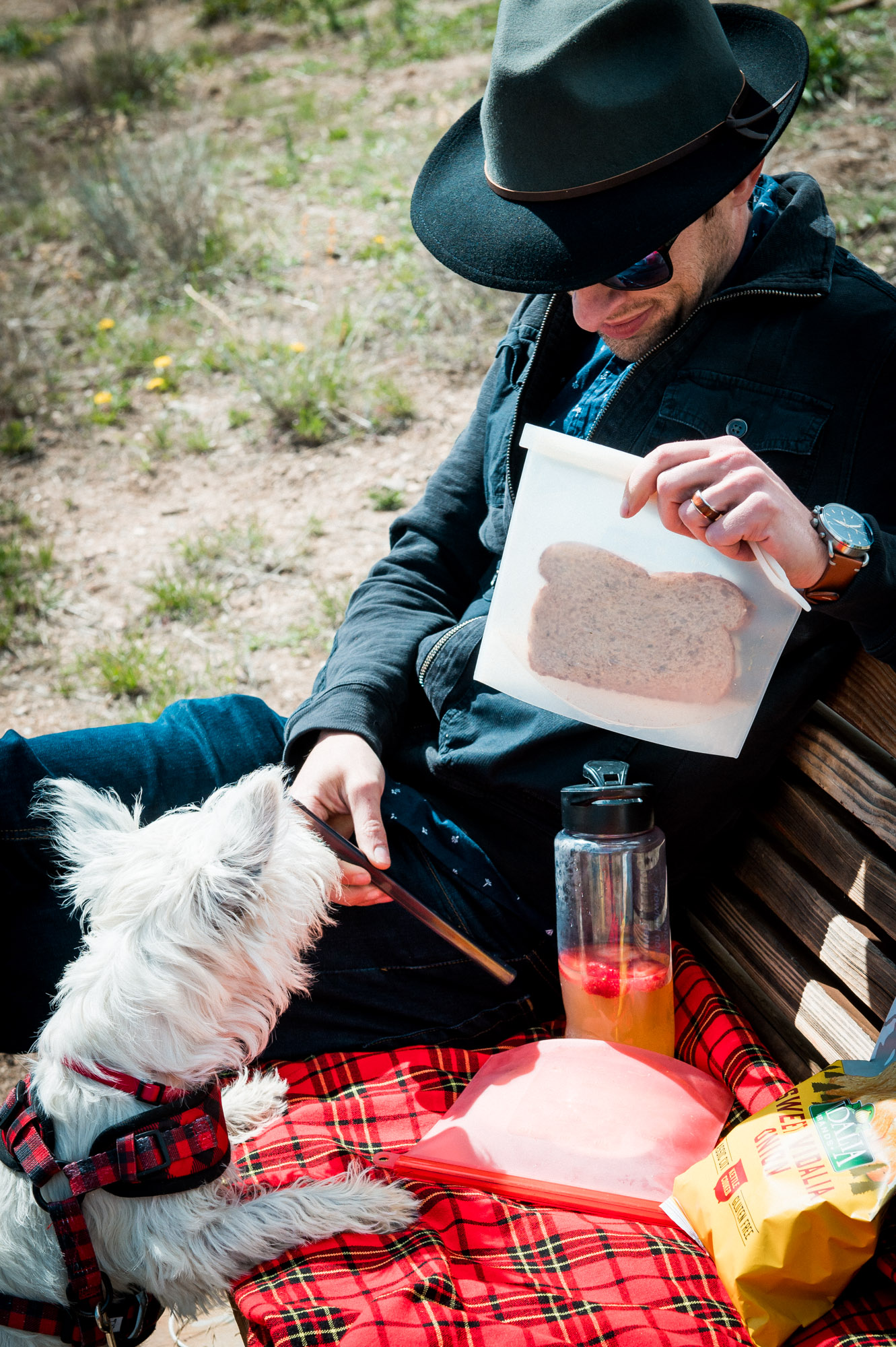 Husband, pup and a basic picnic on a bench.