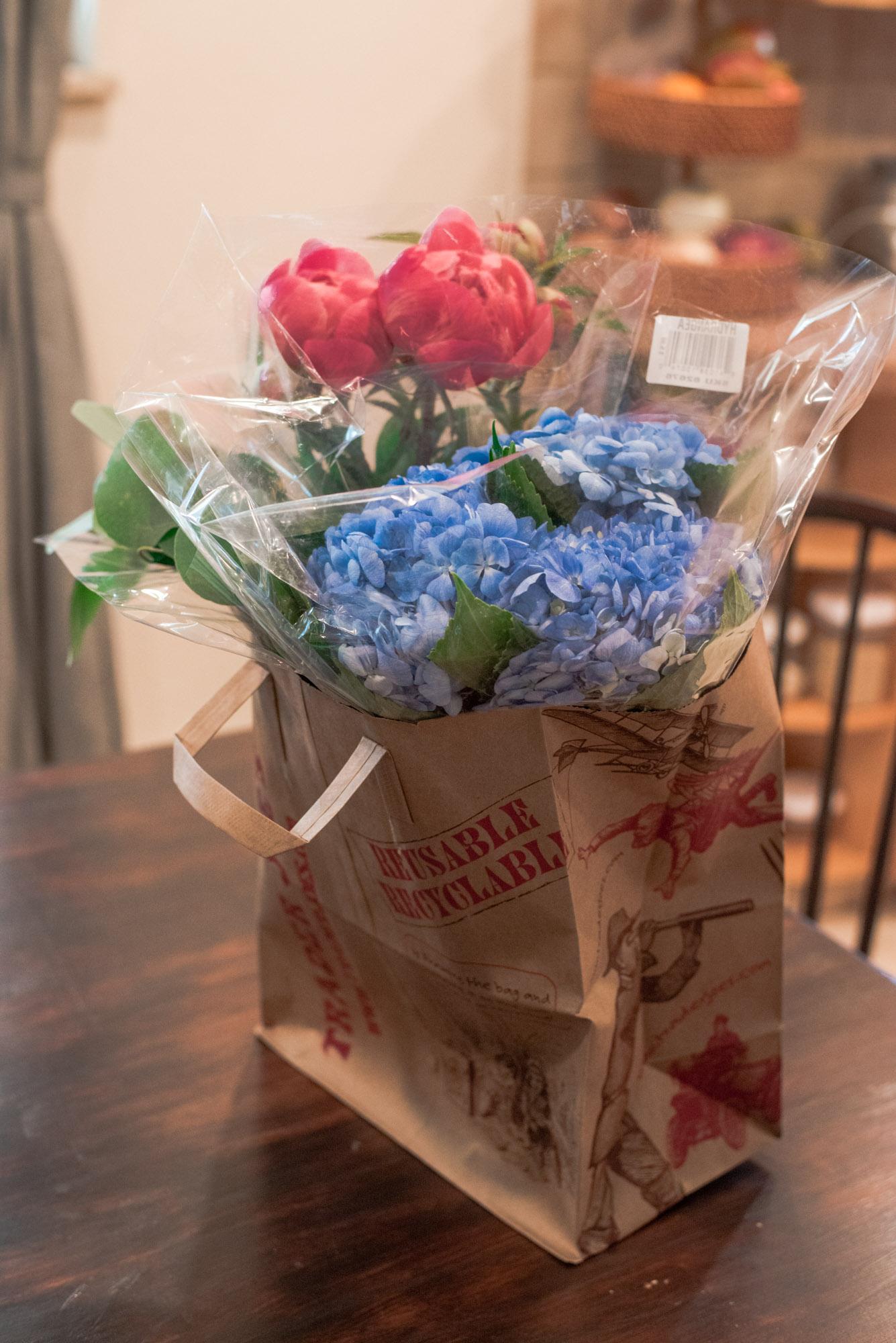 Grocery Store Flowers in trader joes bag