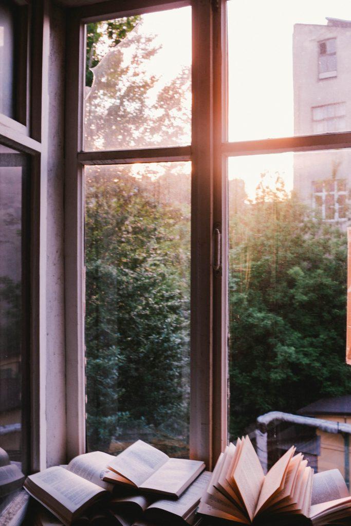 Sun shining through the window onto open books