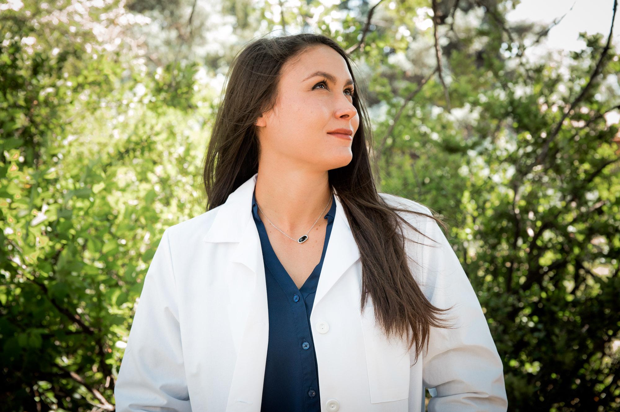 Lesha Estrada in her White coat